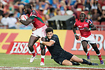 Tone Ng Shiu of New Zealand tries to tackle Dennis Onkeo Ombachi of Kenya who runs with the ball during the match New Zealand vs Kenya, Day 2 of the HSBC Singapore Rugby Sevens as part of the World Rugby HSBC World Rugby Sevens Series 2016-17 at the National Stadium on 16 April 2017 in Singapore. Photo by Victor Fraile / Power Sport Images