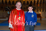 Cathal Furlong former from Scoil An Ghleanna Dingle standing with Fr Michael Moynihan at his Confirmation in in St Mary's Church in Dingle on Friday