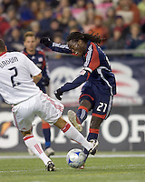 New England Revolution midfielder Shalrie Joseph (21) shoots as Chicago Fire defender C.J. Brown (2) defends. The New England Revolution tied the Chicago Fire, 0-0, at Gillette Stadium on October 17, 2009.