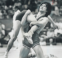 Gets a leg up: Ray Takahashi of Ottawa snashes his teeth as he lifts Hungarian opponent Mihaly Gyulai from floor and gets set to smash him down again during Canadian's 10-4 win on points in Olympic freestyle wrestling.