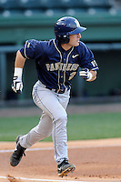 Shortstop Dylan Wolsonovich (2) of the University of Pittsburgh Panthers runs out a fly ball in a game against the Presbyterian Blue Hose on Tuesday, March 11, 2014, at Fluor Field at the West End in Greenville, South Carolina. Pitt won, 12-3. (Tom Priddy/Four Seam Images)