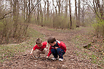 Both of my sons stop mid-hike to dig in the dirt at Lincoln Memorial Gardens in Springfield, Ill.