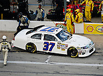 Tony Raines, driver of the (37) Front Row Motorsports Ford, makes a pit stop  during the Samsung Mobile 500 Sprint Cup race at Texas Motor Speedway in Fort Worth,Texas.