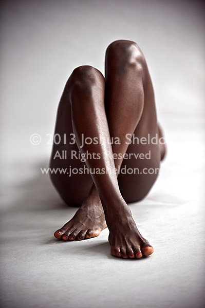 Low angle view of crossed African American legs