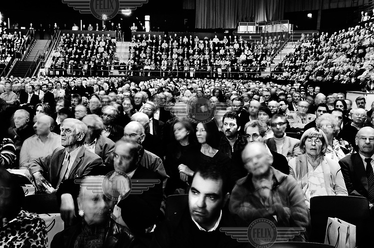 Shareholders attending the annual general meeting of UBS, Switzerland's biggest bank, in a concert hall in Basel. There was a shareholder's revolt over the conduct of the bank's previous administration, which attendees regarded as responsible for record losses for a Swiss company, following exposure to the US sub-prime market and also a major investigation in the US into organised tax evasion that has called into question the whole concept of Switzerland's hallowed banking secrecy. Furthermore, a new scandal emerged in September 2011 when a rogue trader based in London was discovered to have lost in the region of USD 2.3 billion in unauthorised trading. In response Oswald Grubel, Group Chief Executive Officer at UBS, resigned.