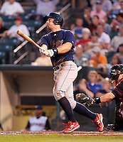 Lehigh Valley IronPigs catcher Erik Kratz #19 hits a home run during a game against the Rochester Red Wings at Frontier Field on August 18, 2011 in Rochester, New York.  Lehigh Valley defeated Rochester 11-1.  (Mike Janes/Four Seam Images)