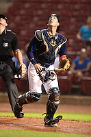 Cedar Rapids Kernels catcher Mitch Garver (25) tracks a foul ball pop up during a game against the Quad Cities River Bandits on August 18, 2014 at Perfect Game Field at Veterans Memorial Stadium in Cedar Rapids, Iowa.  Cedar Rapids defeated Quad Cities 4-2.  (Mike Janes/Four Seam Images)