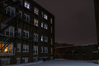 An apartment building at night in a snowstorm in Davis Square in Somerville, Massachusetts, on Tue., Jan. 26, 2021.