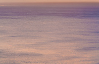 Zooming in to isolate the sea yielded this abstract view of a Honolulu sunset.<br /> <br /> Canon EOS 5D, 70-200 f/2.8 L lens with 1.4x teleconverter