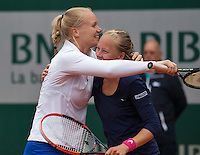Paris, France, 29 June, 2016, Tennis, Roland Garros, Womans doubles: Kiki Bertens (NED) and her partner Johanna Larsson (SWE) (R) defeat the Williams sisters and celebrate. <br /> Photo: Henk Koster/tennisimages.com