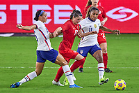 18th February 2021, Orlando, Florida, USA;  Canada midfielder Jessie Fleming (17) battles with United States forward Lynn Williams (6) and United States midfielder Catarina Macario (11) during a SheBelieves Cup game between Canada and the United States on February 18, 2021 at Exploria Stadium in Orlando, FL.