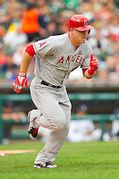 Mike Trout (27) of the Los Angeles Angels hustles down the first base line against the Detroit Tigers at Comerica Park on June 25, 2013 in Detroit, Michigan.  The Angels defeated the Tigers 14-8.  (Brian Westerholt/Four Seam Images)