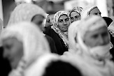 A local woman is watching the celebration of the wedding ceremony in the village of Ribnovo, some 200 km from Sofia, Bulgaria.