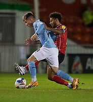 Manchester City U21's Ben Knight is tackled by Lincoln City's Liam Bridcutt<br /> <br /> Photographer Chris Vaughan/CameraSport<br /> <br /> EFL Papa John's Trophy - Northern Section - Group E - Lincoln City v Manchester City U21 - Tuesday 17th November 2020 - LNER Stadium - Lincoln<br />  <br /> World Copyright © 2020 CameraSport. All rights reserved. 43 Linden Ave. Countesthorpe. Leicester. England. LE8 5PG - Tel: +44 (0) 116 277 4147 - admin@camerasport.com - www.camerasport.com
