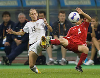 USA forward (13) Kristine Lilly slides into North Korea midfielder (2) Kim Kyong Hwa. The United States (USA) and North Korea (PRK) played to a 2-2 tie during a FIFA Women's World Cup China 2007 opening round Group B match at Chengdu Sports Center Stadium, Chengdu, China, on September 11, 2007.