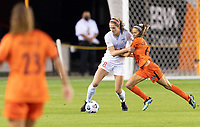HOUSTON, TX - APRIL 09: Kayla Sharples #28 of the Chicago Red Stars and Shea Groom #6 of the Houston Dash battle for control of the ball during a game between Chicago Red Stars and Houston Dash at BBVA Stadium on April 09, 2021 in Houston, Texas.