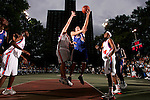 Cole Aldrich (45) goes up for a layup with defense by Kevin Love (42) during the Elite 24 Hoops Classic game on September 1, 2006 held at Rucker Park in New York, New York.  The game brought together the top 24 high school basketball players in the country regardless of class or sneaker affiliation.