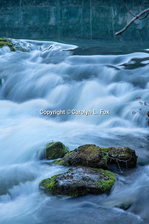 A slow shutter speed makes water look silky as it pours over rocks in Eminence, Missouri.