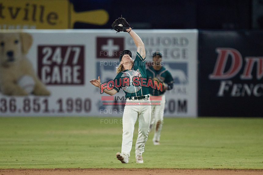 Greensboro Grasshoppers second baseman Aaron Shackelford (44) catches a pop fly during the game against the Winston-Salem Dash at First National Bank Field on June 3, 2021 in Greensboro, North Carolina. (Brian Westerholt/Four Seam Images)