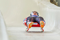 5 December 2014: Chris Mazdzer, sliding for the USA, crosses the finish line on his first run, ending the day with a 4th place finish and a combined 2-run time of 1:43.205 in the Men's Competition at the Viessmann Luge World Cup, at the Olympic Sports Track in Lake Placid, New York, USA. Mandatory Credit: Ed Wolfstein Photo *** RAW (NEF) Image File Available ***