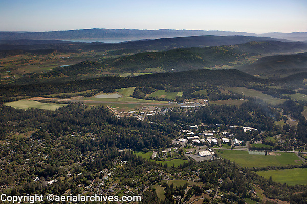 aerial photograph of Pacific Union College and Angwin-Parrett Field (2O3), Angwin, Napa County, California; Pope Valley and Lake Berryessa in the background