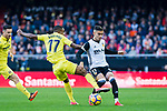 Andreas Pereira of Valencia CF (R) fights for the ball with Cedric Bakambu of Villarreal CF (L) during the La Liga 2017-18 match between Valencia CF and Villarreal CF at Estadio de Mestalla on 23 December 2017 in Valencia, Spain. Photo by Maria Jose Segovia Carmona / Power Sport Images
