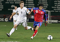 Robbie Rogers #9 of the USA with Cristian Bolanos #13 of Costa Rica during a 2010 World Cup qualifying match in the CONCACAF region at RFK Stadium on October 14 2009, in Washington D.C.The match ended in a 2-2 tie.