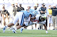 CHAPEL HILL, NC - NOVEMBER 14: Jaquarii Roberson #5 of Wake Forest is tackled by Ja'Qurious Conley #0 and Jeremiah Gemmel #44 of North Carolina after catching a pass during a game between Wake Forest and North Carolina at Kenan Memorial Stadium on November 14, 2020 in Chapel Hill, North Carolina.