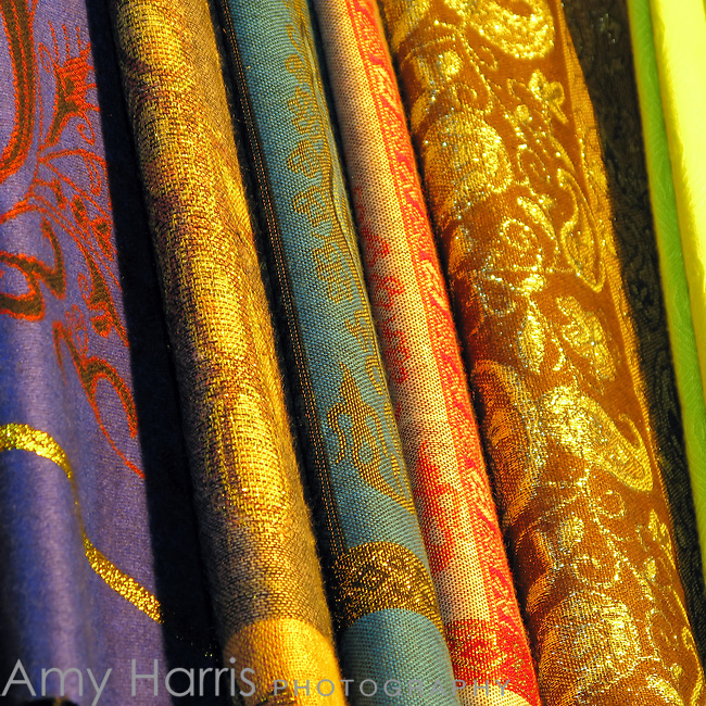 Stack of colorful Egyptian fabrics at market in Cairo, Egypt.