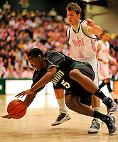 13 February 2011: Binghamton University Bearcat forward Greer Wright, a Senior from  Boynton Beach, FL, in action against the University of Vermont Catamounts at Patrick Gymnasium in Burlington, Vermont. The Catamounts came from behind to defeat the Bearcats 60-51 in their America East matchup. The Cats took part in the National Pink Zone Breast Cancer Awareness Program by wearing special white jerseys with pink trim. The jerseys were auctioned off following the game with proceeds going to the Vermont Cancer Center. Mandatory Credit: Ed Wolfstein Photo