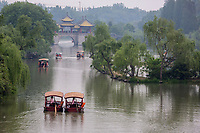 Yangzhou, Jiangsu, China.  Pleasure Boats Approaching Five Pavilion Bridge, Slender West Lake Park, Hazy Day.