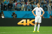 Jordan Henderson of England looks dejected
