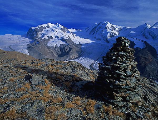 Stone turret and Monte rosa massif with Gorner and Grenz glaciers, Gornergrat, Zermatt, Swiss Alps, Switzerland, Europe