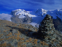 Stone turret and Monte rosa massif with Gorner and Grenz glaciers, Gornergrat, Zermatt, Swiss Alps, Switzerland, Europe