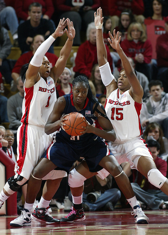 Rutgers vs University of Connecticut in Big East Women's Basketball at the Louis Brown Athletic Center, Piscataway, Nj.  UCONN's # 31 (center)- Tina Charles is blocked by Rutgers # 1 (left) Khadijah Rushdan and # 15 (right) Kia Vaughn..SPORTS.5495.ON MON MAR. 2,2009./CHIEF PHOTOGRAPHER