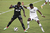 RICHMOND, VA - SEPTEMBER 30: Cherif Dieye #70 of New York Red Bulls II and Hadji Barry #92 of North Carolina FC challenge for the ball during a game between North Carolina FC and New York Red Bulls II at City Stadium on September 30, 2020 in Richmond, Virginia.