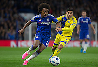 Willian of Chelsea holds off Avi Rikan of Maccabi Tel Aviv during the UEFA Champions League match between Chelsea and Maccabi Tel Aviv at Stamford Bridge, London, England on 16 September 2015. Photo by Andy Rowland.
