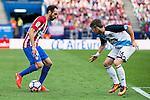 Atletico de Madrid's player Juanfran Torres and Deportivo de la Coruña's player Luisinho during a match of La Liga Santander at Vicente Calderon Stadium in Madrid. September 25, Spain. 2016. (ALTERPHOTOS/BorjaB.Hojas)