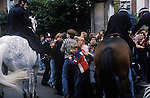 Arsenal football fans after a game police crowd control on horseback. London. UK