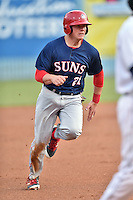 Hagerstown Suns catcher Jackson Reetz (21) runs to third during a game against the Asheville Tourists at McCormick Field on April 27, 2016 in Asheville, North Carolina. The Tourists defeated the Suns 14-7. (Tony Farlow/Four Seam Images)