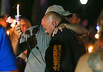 Carson City Sheriff's deputies console each other at a candlelight vigil in Carson City, Nev., on Saturday, Aug. 15, 2015. Hundreds of residents came out to show their support for the family and department after a deputy was killed in the line of duty early Saturday morning after responding to a domestic violence call. <br /> Photo by Cathleen Allison