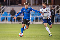 SAN JOSE, CA - MAY 01: Cade Cowell #44 of the San Jose Earthquakes dribbles away from Brendan Hines-Ike #4 of DC United during a game between San Jose Earthquakes and D.C. United at PayPal Park on May 01, 2021 in San Jose, California.