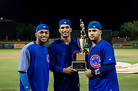 Fauris Guerrero, Yovanny Cuevas (61), and Richard Nunez (8) hold the Chuck Jared Championship Cup after winning Game Three of the Arizona League Championship Series against the AZL Giants on September 7, 2017 at Scottsdale Stadium in Scottsdale, Arizona. AZL Cubs defeated the AZL Giants 13-3 to win the series two games to one. (Zachary Lucy/Four Seam Images)