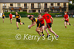 Jason Clifford for Dr Crokes in attack comes under pressure as Glenbeigh/Glencar's Daniel Griffin & Liam Smith close in from two sides.