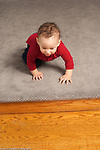 9 month old baby boy crawling heading for small flight of stairs