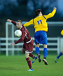 Keith Greany of  Galway  in action against Ian Collins of Clare during their Oscar Traynor game at Healy Park. Photograph by John Kelly.