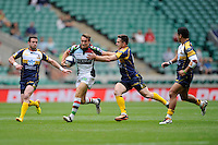 Miles Mantella of Harlequins 7s is tackled by Robbie Coleman of the Brumbies during the World Club 7s at Twickenham on Saturday 17th August 2013 (Photo by Rob Munro)