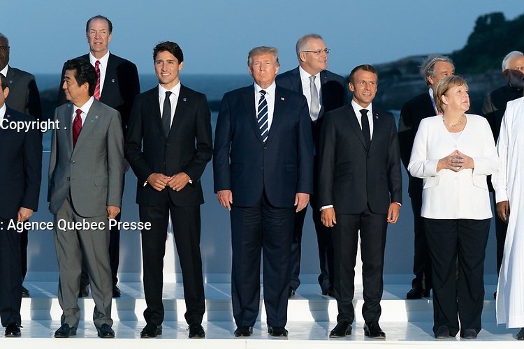 """President Donald J. Trump joins the G7 Leadership and Extended G7 members as they pose for the """"family photo"""" at the G7 Extended Partners Program Sunday evening, Aug. 25, 2019, at the Hotel du Palais Biarritz, site of the G7 Summit in Biarritz, France. (Official White House Photo by Andrea Hanks)"""