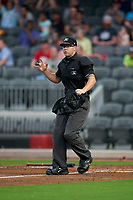 umpire Mark Bass during a Carolina League game between the Down East Wood Ducks and Fayetteville Woodpeckers on August 13, 2019 at SEGRA Stadium in Fayetteville, North Carolina.  Fayetteville defeated Down East 5-3.  (Mike Janes/Four Seam Images)