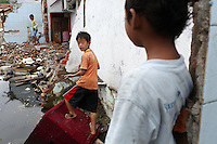 Children play in the ruins of a flooded district in the northern port area of Jakarta. Almost 40% of Jakarta lies below sea-level leading to flooding in many areas, even during the dry season.